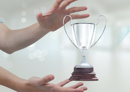 Digital composite of Woman with a trophy on hands Stock Photo