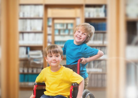 Digital composite of Disabled boy in wheelchair with friend in school library Stock Photo