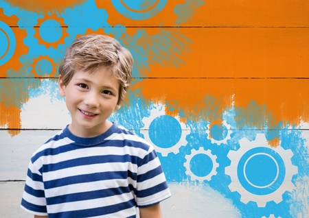Digital composite of Boy in front of painted orange wall and settings cogs gears Stock Photo