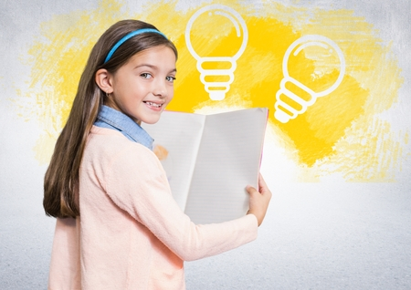 Digital composite of Girl reading book in front of lightbulbs Stock Photo