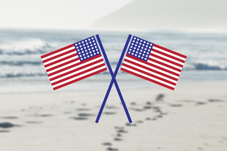 Digital composite of USA flags in the beach Stock Photo