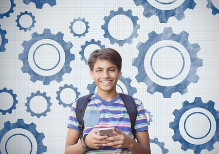 Digital composite of Student holding phone in front of settings gears cog Stock Photo