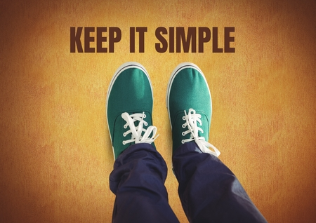 Digital composite of Keep it simple text and Green shoes on feet with rustic background