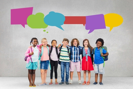 Digital composite of Happy students with speech bubble against grey background Stock Photo