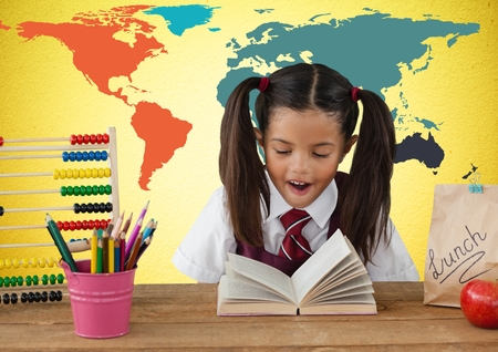 Digital composite of school kids writing at desk in front of stock 84126201 digital composite of schoolgirl at desk in front of colorful world map gumiabroncs Gallery
