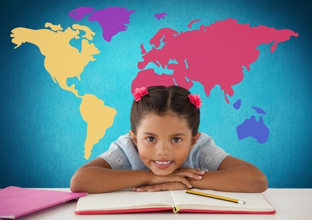 paraplegico: Digital composite of Schoolgirl at desk in front of colorful world map