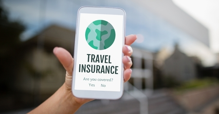 wireless communication: Digital composite of Person holding a phone with travel insurance concept on screen