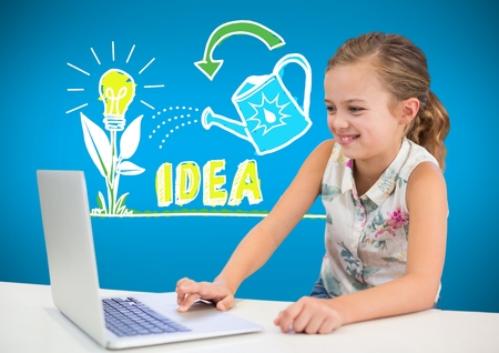 Digital composite of Girl on laptop with colorful idea graphics