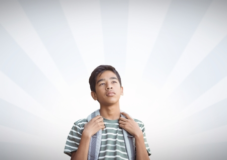 Digital composite of Student with light streams background