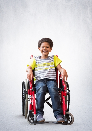 Digital composite of Disabled boy in wheelchair with bright background