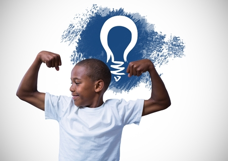 Digital composite of Strong boy flexing muscles in front of light bulb graphic