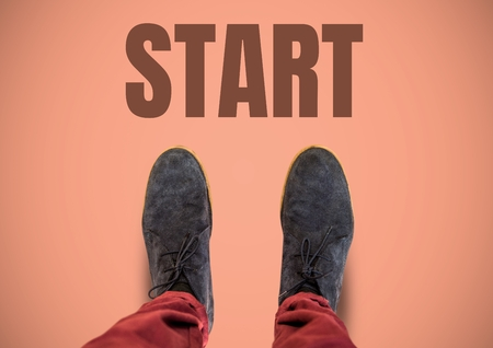 Digital composite of Start text  and brown shoes on feet with pink background