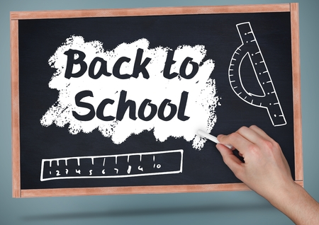 digitally generated image: Digital composite of Hand writing back to school on blackboard with chalk and rulers