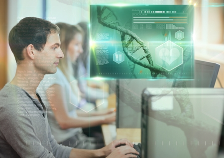 Digital composite of Male Student studying with computer and science education interface graphics overlay