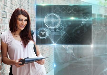 Composite numérique de l'élève féminin avec des dossiers et des sciences de l'éducation interface de recouvrement des graphiques Banque d'images - 84126070