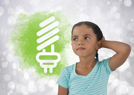 Digital composite of Girl thinking next light bulb graphic Stock Photo