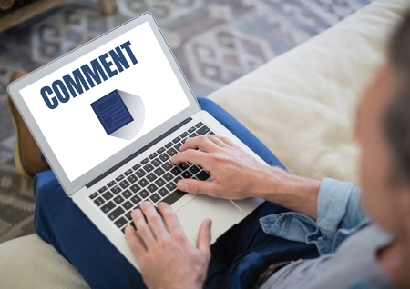 couch: Digital composite of Comment text and graphic on laptop screen with hands Stock Photo