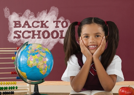 digitally generated image: Digital composite of Student girl at table against red blackboard with back to school text Stock Photo