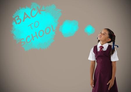 Digital composite of Schoolgirl dreaming of back to school text