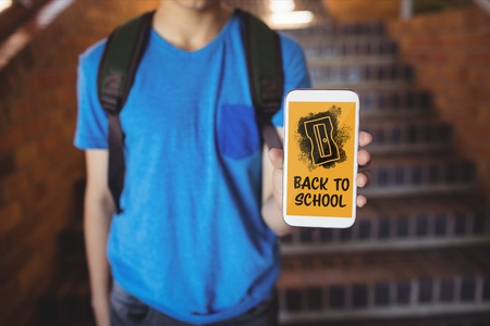 Digital composite of Boy holding a phone with back to school text on screen