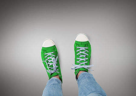 woman laptop: Digital composite of Green shoes on feet with grey background