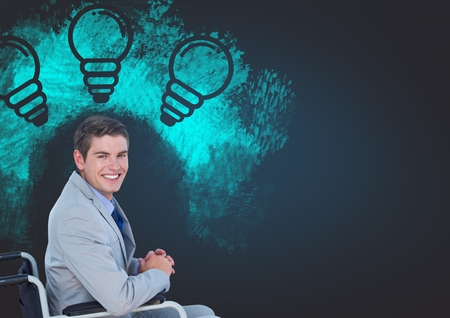 Digital composite of Disabled businessman in wheelchair with light bulb drawings