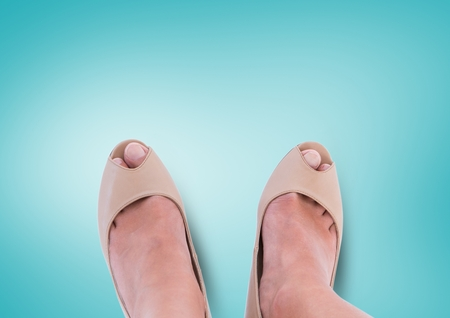 praise: Digital composite of Beige shoes on feet with blue background