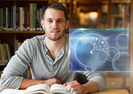 Digital composite of Male Student studying with book and science education interface graphics overlay