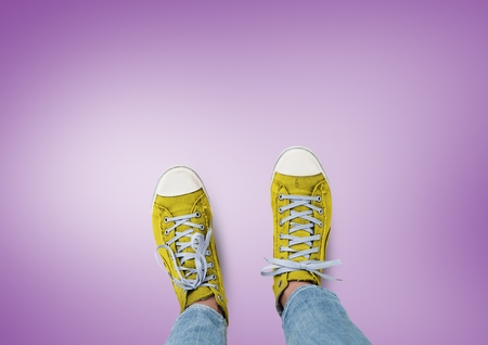 ominous: Digital composite of Yellow shoes on feet with purple background