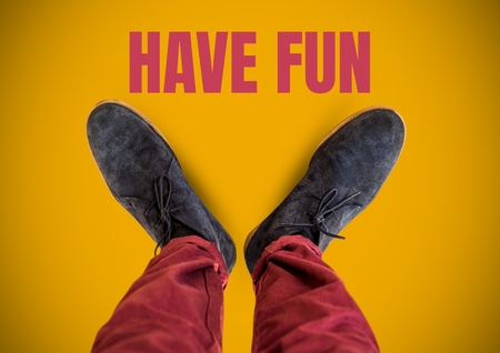 Digital composite of Have fun text and Grey shoes on feet with yellow background