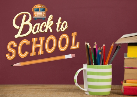 Digital composite of Books on the table against red blackboard with back to school illustration