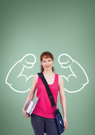 Digital composite of Happy student woman with fists graphic standing against green background