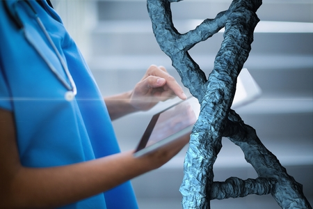 Digital composite of Doctor woman using a tablet with 3D DNA strands