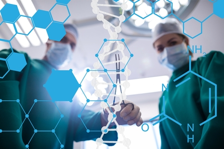 Digital composite of Doctor standing with DNA and medical interface