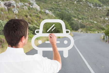 Digital composite of Business man drawing a car on the road Stock Photo