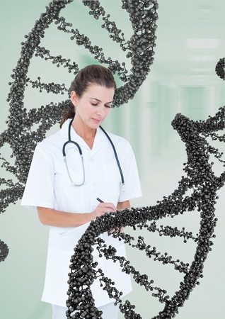 Digital composite of Doctor woman standing with 3D DNA strand Stock Photo