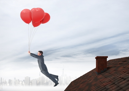 Digital composite of Businessman floating with balloons by Roof with chimney and foggy city Stock Photo