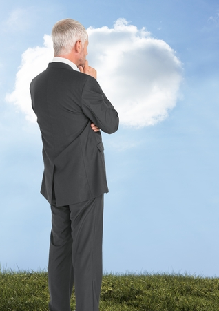 Digital composite of Businessman thinking with sky cloud