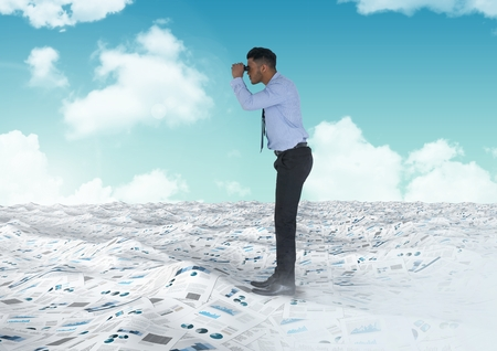 man looking out: Digital composite of Businessman holding binoculars in sea of documents under sky clouds Stock Photo