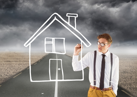 Digital composite of Man drawing a house on the road
