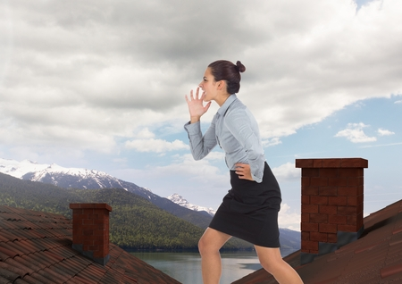 Digital composite of Businesswoman standing on Roofs with chimney and mountain lake landscape