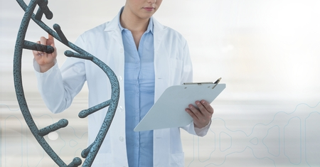 Digital composite of Doctor woman interacting with 3D DNA strand Stock Photo