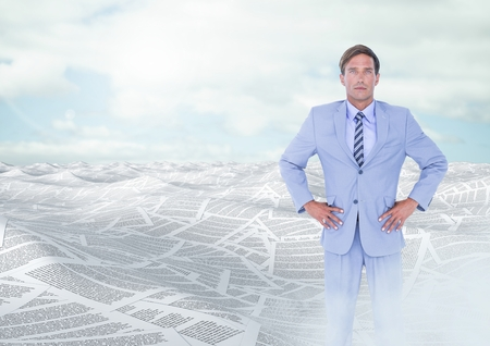 Digital composite of Businessman in sea of documents under sky clouds Stock Photo