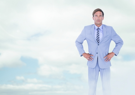 Digital composite of Businessman under sky clouds