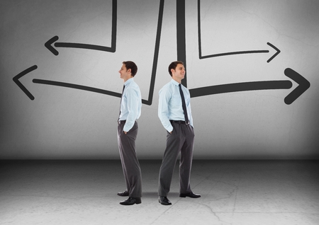 Digital composite of Left or right arrows drawings with Businessman looking in opposite directions