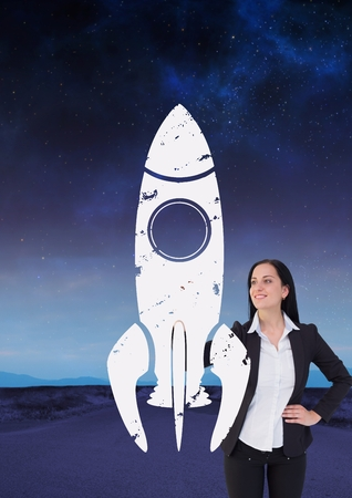Digital composite of Business woman drawing a rocket on the road Stock Photo