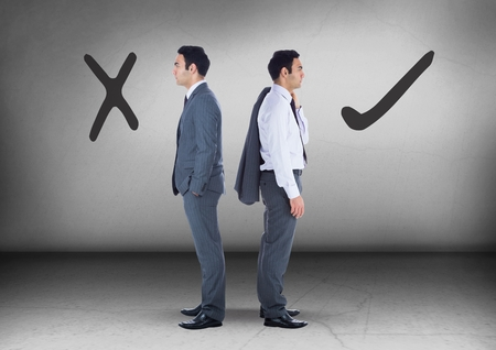 Digital composite of Correct Right or wrong drawings with Businessman looking in opposite directions Stock Photo