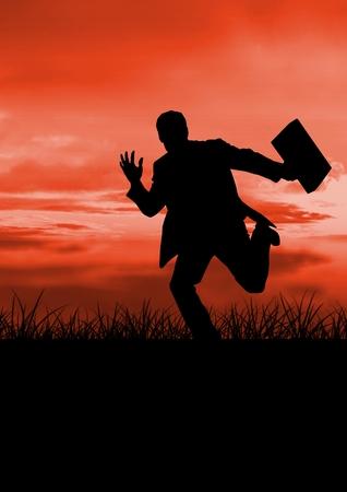 Digital composite of Business man running silhouette against sunset or sunrise Stock Photo