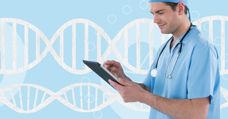 Digital composite of Doctor man using a tablet with 3D DNA strand