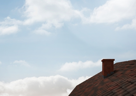 Digital composite of Roof with chimney and sky